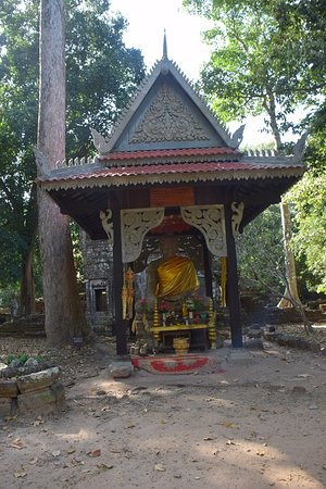 Pavilion with Buddha Statue in front of the temple