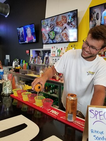 Bartender Conner! Pouring one our signature bombs - the KnoxVegas bomb!