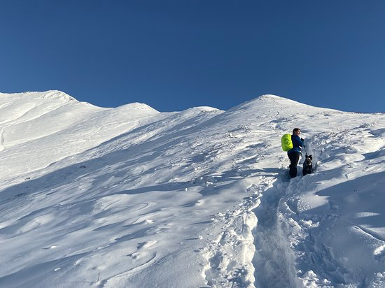 Anchorage, AK : Ascend a winter peak and capture the beauty of the Chugach State Park, with peaks and valleys extending away as far as the eye can see.