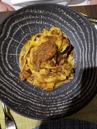 ribbon pasta with rabbit ragu sauce