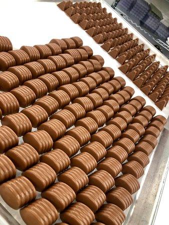 "Pistachio Creams and Peanut ""Sparkle"" Pyramids in Valrhona milk chocolate."