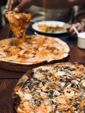 "12"" Wood fired thin crust handmade pizza."