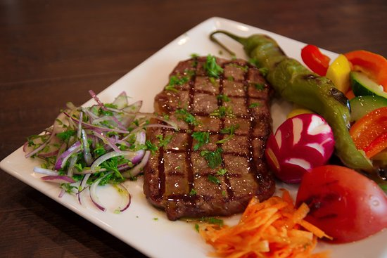 Sirloin Steak (Center cut Sirloin steak, marinated in olive oil and chef's special blend of spices.)