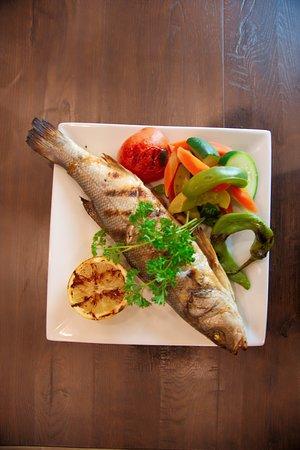 Branzino (Sea Bass) (Grilled whole branzino, drizzled over lemon olive oil sauce. Served with rice pilav, bulgur pilav, or vegetables.)