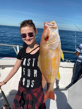 Young woman with a huge snapper!