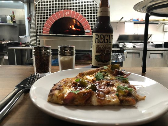 Come in and enjoy some pizza and beer.