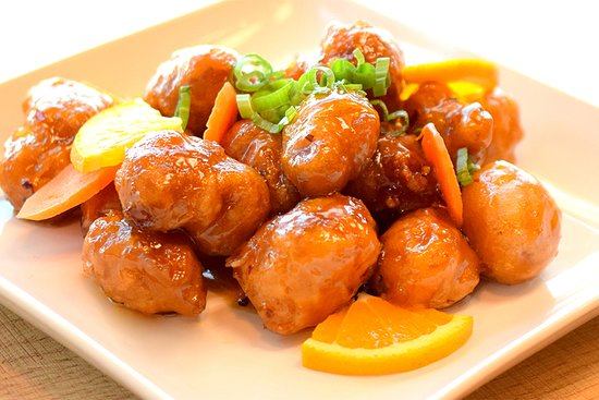 Orange Chicken-  Crispy fresh battered chicken, Carrot slices, with a tangy homemade orange sauce made with REAL oranges and their juice and NO Corn Syrup.  A Customer Favorite! Can be done without batter and can also be done with beef, Tofu or Shrimp!