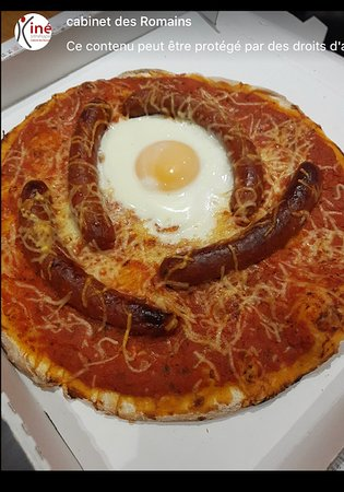 Pizza merguez avec un oeuf (photo d'un client)
