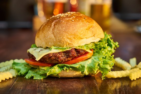 San Jose Succotz, Belize : Your choice of Chicken or Beef Burgers. Either way, these are grilled to satisfaction, lettuce, sliced tomatoes, pickles, topped with melted American Swiss cheese, ketchup.   Choose other options from our menu.