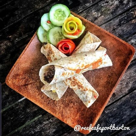 Try our different kinds of New York  bagels and our breakfast burritos.  Comes with salad or slices of fruits and a choice of French press coffee or lemonade.