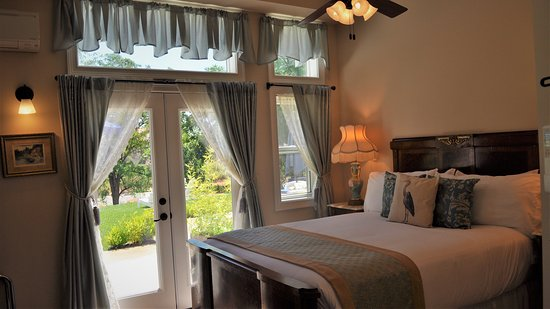 Blue Heron Suite with its private patio out on to the river lawn terrace at the River Belle Inn