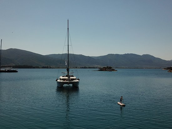 Anchored Catamaran with people using the SUP