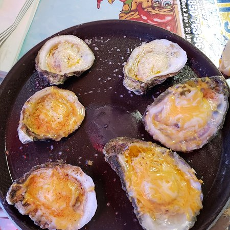 Some of the best oysters I've ever  had. We purchased three half dozen; 3 cheese cajun, baked garlic parmesan, and 3 cheese jalapeno. We shared and thoroughly enjoyed. The fried crab claws were also good. Small restaurant and limited seating but good service.
