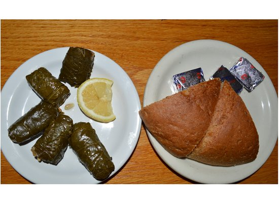 Dolmadakia stuffed grape leaves appetizer, and delicious Poppi's Greek Peasant bread with fennel