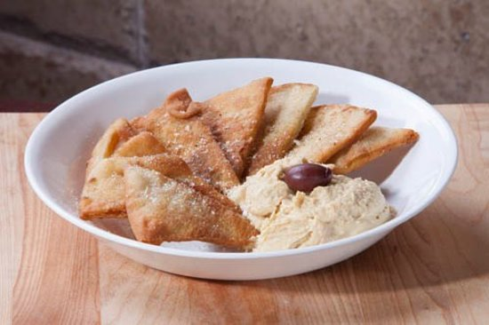 Traditional hummus with fried pita bread.