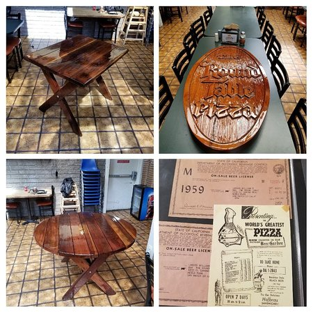 The only existing original Redwood Round Table from 1959 amongst other items on display at the original Round Table Pizza in Menlo Park.