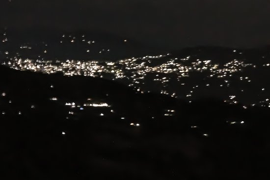 Night view of Kalimpong from resort balcony as well as room.