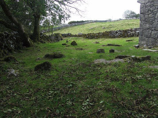 Graves and stone walls by a 12th Century church on an old pilgrim's route