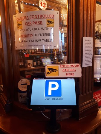 Parking registration tablet fixed to the bar and the signs regarding this - Advertised since Oct 2019