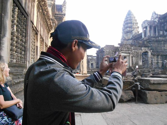 Angkor wat sunrise and Banteay Srei temple Private Day tour: Chen taking an artistic photo for us. Everyone he took was a winner.