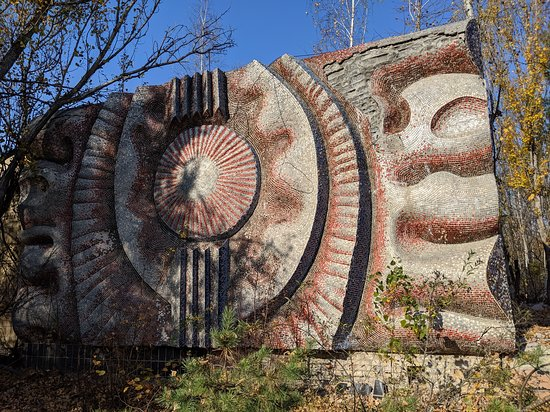 Full-Day Private Tour to Chernobyl and Pripyat Town from Kyiv: Architectural art on P{ripyat buildings - being overtaken by vegetaion