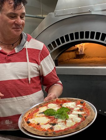 Franco with a Margherita pizza hot out of the brick oven