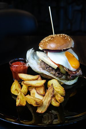 burgers in rolls made by us and served with fries made by us too