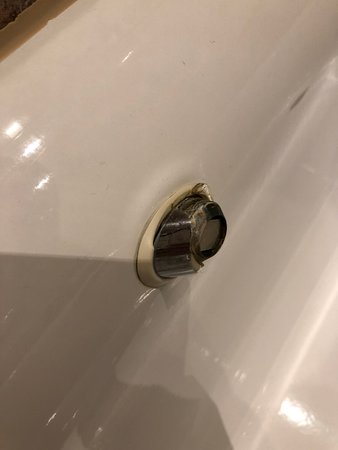 vile unclean ripped off handle in the bath