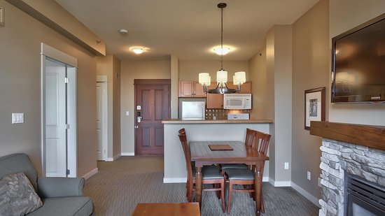 VILLAGE ONE-BEDROOM SUITE-Featuring a full kitchen,1 queen bed in a private bedroom & a sofa bed