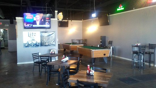 Part of inside showing pool tables