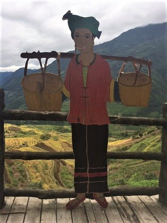 Wooden figure balancing baskets