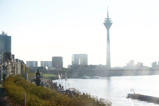 Rheinuferpromenade with the Rheintower as backdrop