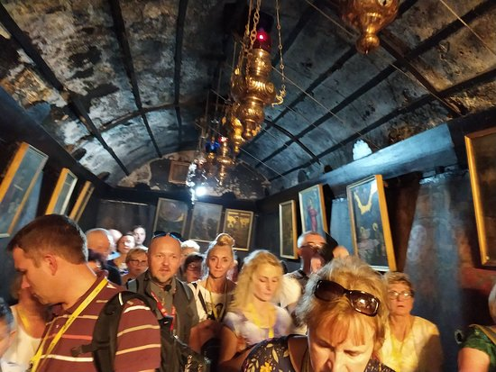 Passages in the cave of manger and birth place of Jesus Christ. Tremendous crowds from all over the world.