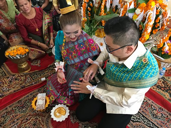 LAOS WEDDING Celebration of a young couple getting married in traditional Laos style.