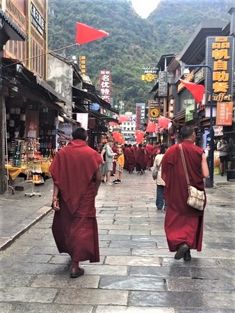 Tibetan monks, looking for West Street bargains like the rest of us