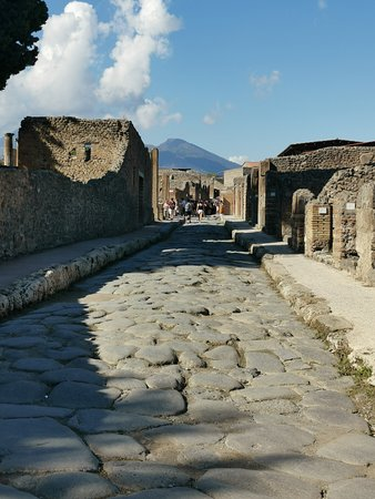 Pompeii Ruins & Mt Vesuvius Volcano Day Trip from Rome: Streets of Pompeii looking toward Vesuvius