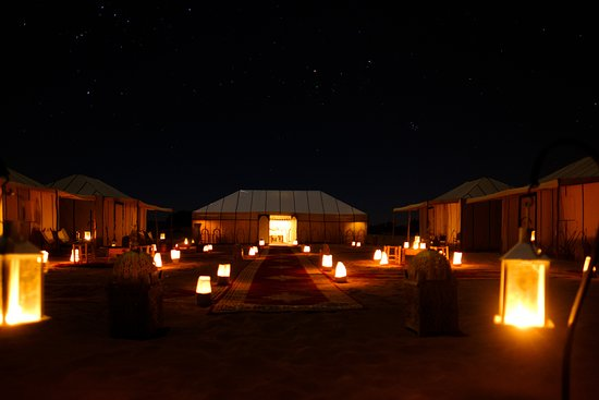 Dihya Desert Camp: This pictures is for the outside of the tents by night