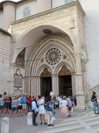 Entrance to the Lower Church and Crypt where the remains of San Francesco can be found. Mid-afternoon and many visitors.