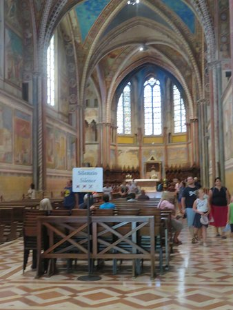 Interior of the Upper Church features a single open nave and frescos. Frescos rather than glass windows carry the church's messages in Italian churches.