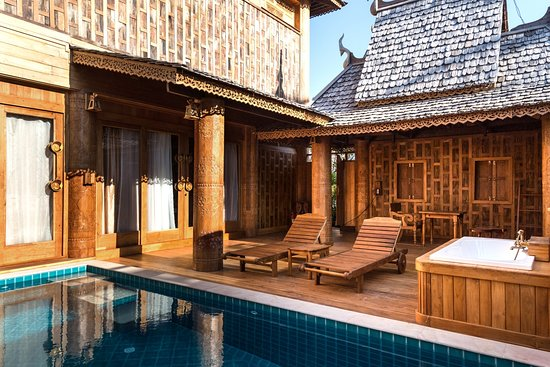 Garden Pool Suite is a 140 sq.m. room which is on the lower level of the 2-story villa with a separate entrance from the upper floor (Deluxe Pool Suite). Garden Pool Suite is perfect for a couple or a small family. Guests can relax in a private swimming pool or outdoor sunken bathtub. The room is decorated with Thai style teakwood carvings and stunning fabrics to create warm interiors that combine oriental ambiance with modern luxury comforts.