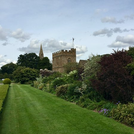 Broughton Castle: Herbaceous border with the Gatehouse beyond