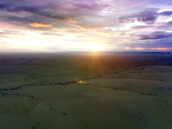 Half-Day Hot Air Balloon Safari and Breakfast in Serengeti: Sun rising over Serengeti.