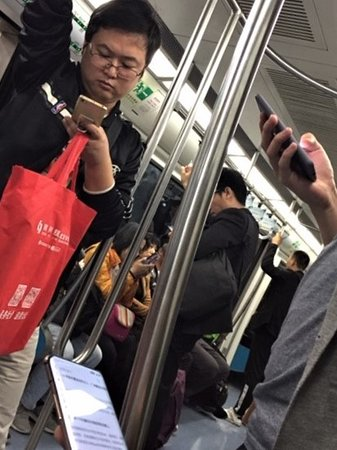 EVERYONE is on their phone on the subways