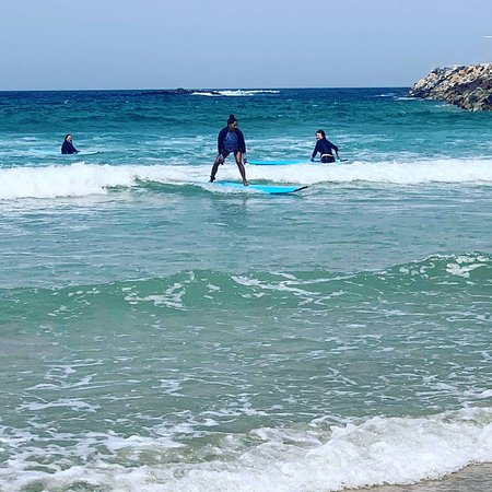 Waves to Wilderness Experiences: 3 staff members participating in the surfing activity