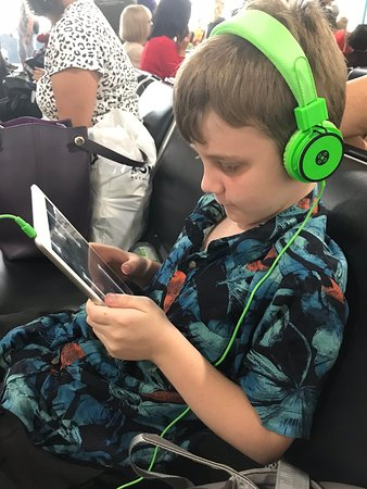 Jetstar Airways - Australia & New Zealand: Thank goodness for iPads!! Only problem was that the chargers were all in the suitcase on the plane and we were there for so long it went flat!