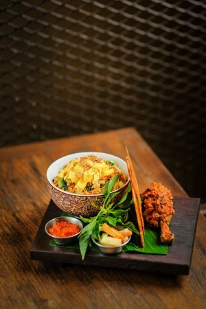 Nasi goreng ayam - the famous Indonesian fried rice with BBQ chicken, chicken crisp, acar & sambal.