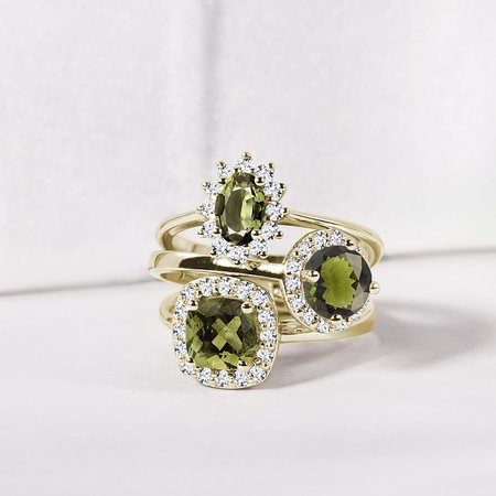 moldavite rings with diamonds in yellow gold