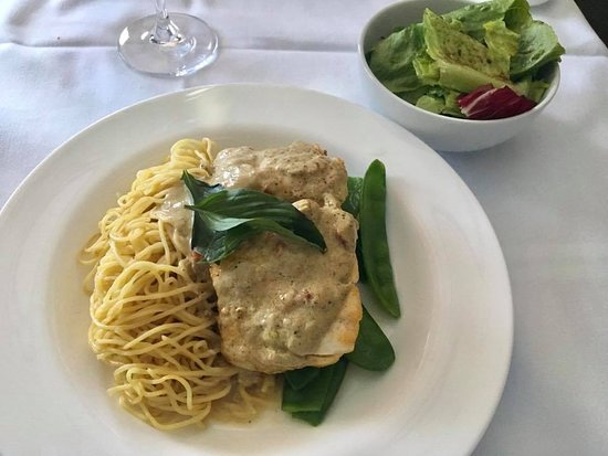 Qantas: Signature snapper poached in garam masala with fine egg noodles and snow peas