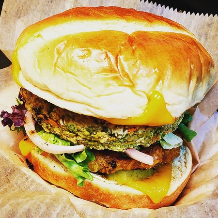 Mediterranian Black-Bean & Veg-ie Double-Stack Burger with melted Cheddar on a Fluffy Brioche Bun