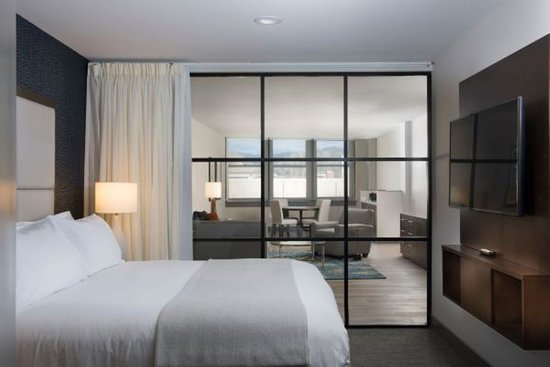 Deluxe City View King Bedroom with view into sitting area